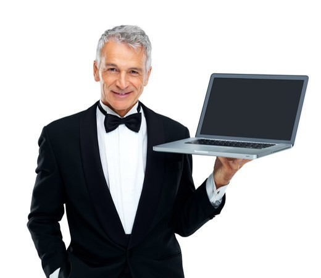 Portrait of senior male executive holding laptop on white background : Stock Photo