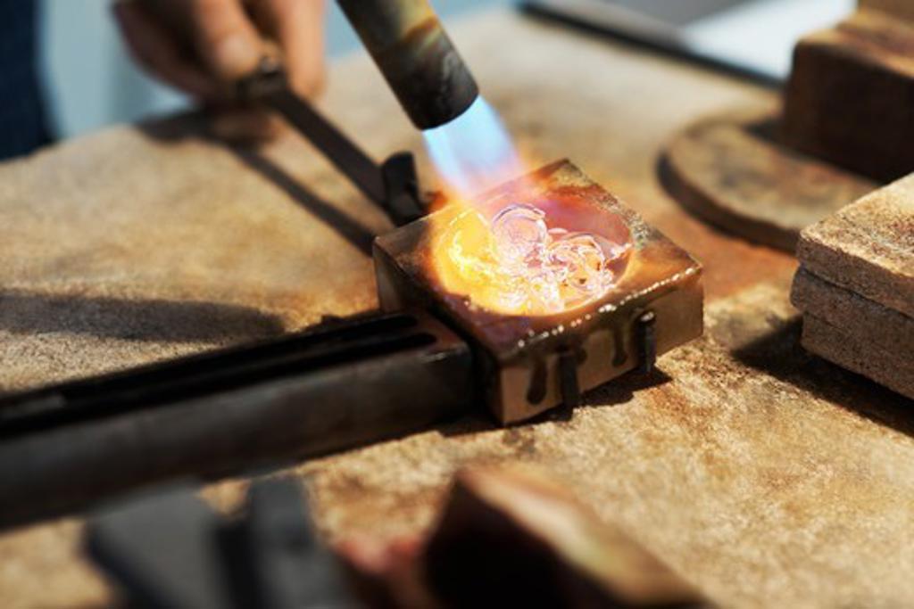 Stock Photo: 4197R-52753 Closeup of a jeweler melting metals