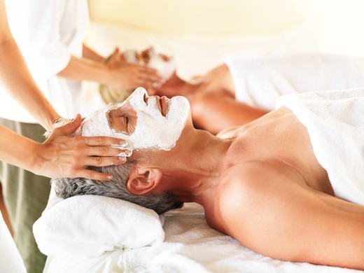 Stock Photo: 4197R-53527 Closeup of relaxing mature couple getting spa treatment