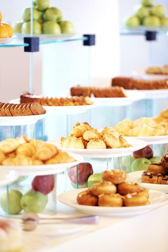 Stock Photo: 4197R-53653 Variety of tasty dessert and fruits for buffet at hotel