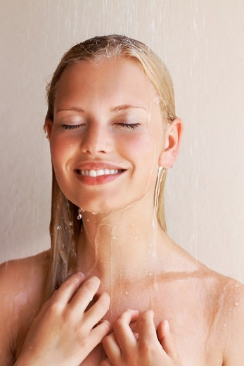 Stock Photo: 4197R-53916 Happy smiling young woman having fresh shower