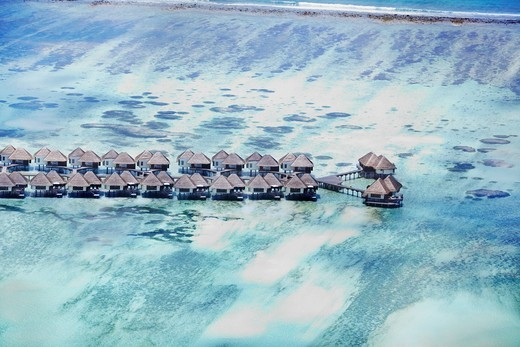 Stock Photo: 4197R-54773 Aerial-view of a group of picturesque cabanas extending into a breathtaking blue sea