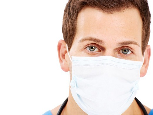 Portrait of a young surgeon wearing a surgical mask : Stock Photo