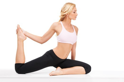 Stock Photo: 4197R-56977 A beautiful woman performing the sitting bow pulling pose while isolated on white