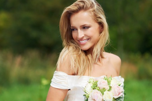 Stock Photo: 4197R-57446 A beautiful young bride has a quiet moment on her wedding day