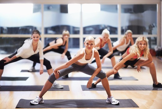Portrait of an attractive young woman leading an aerobics class : Stock Photo
