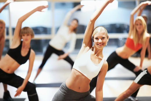 Stock Photo: 4197R-57772 Portrait of an attractive young woman instructing her aerobics class