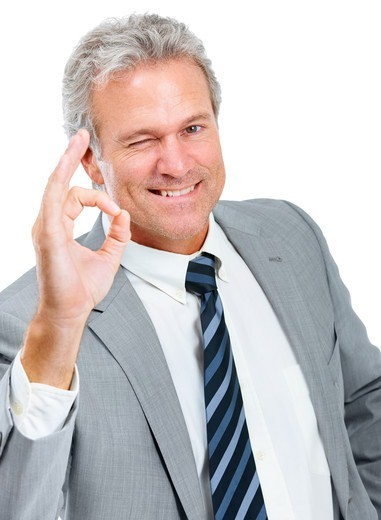 Stock Photo: 4197R-58128 A handsome businessman telling you everything is awesome while isolated on a white background