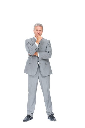 Stock Photo: 4197R-58206 Full-length portrait of a determined executive isolated on a white background
