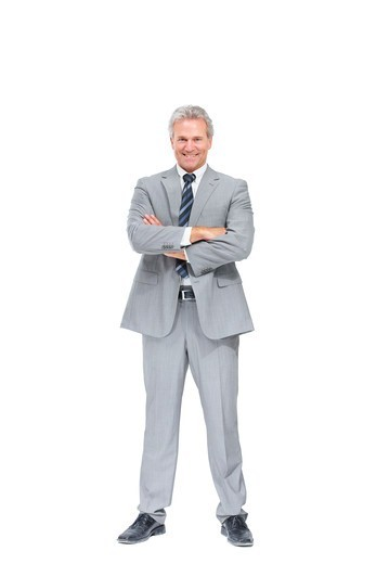 Stock Photo: 4197R-58210 Full-length portrait of a satisfied executive crossing his arms while isolated on white