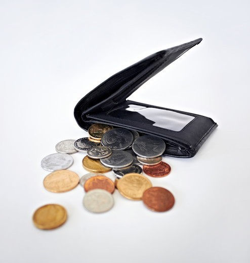 Stock Photo: 4197R-58947 A studio shot of coins with a wallet