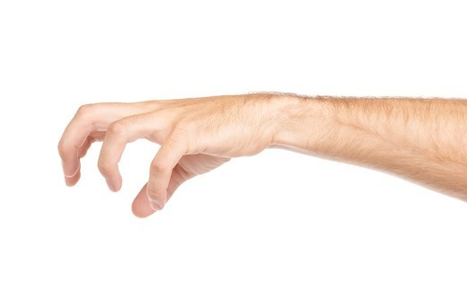 Stock Photo: 4197R-59198 A puppet master's hand pulling on invisible strings
