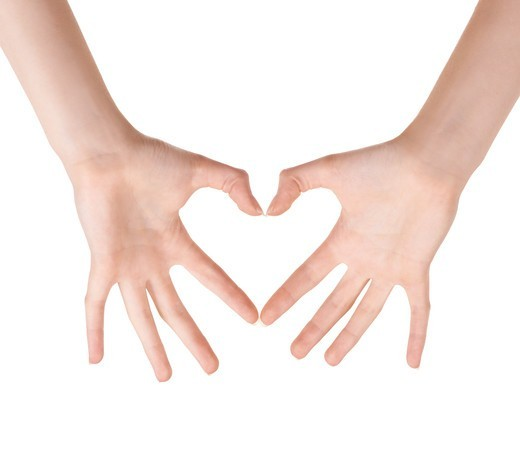 Stock Photo: 4197R-59372 Cropped view of hands making a heart shape against a white background