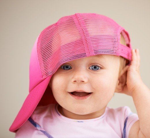Stock Photo: 4197R-59542 A cute little girl wearing an oversized hat