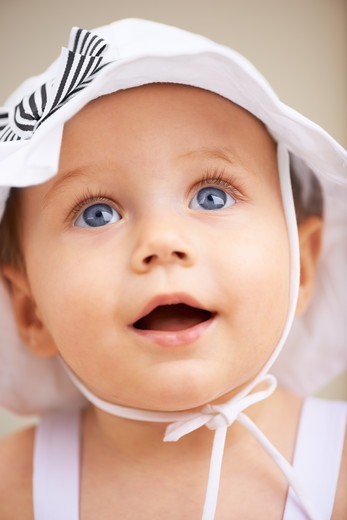 A cute baby girl looking up : Stock Photo
