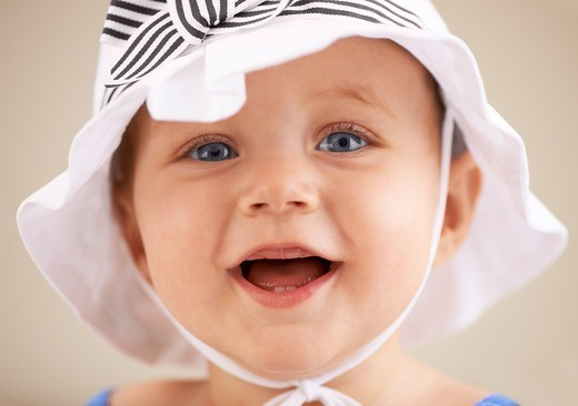 Closeup of a cute baby girl's face : Stock Photo