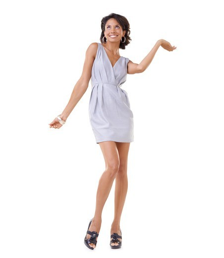 Elegant and excited young African-American woman presenting copyspace with a smile : Stock Photo