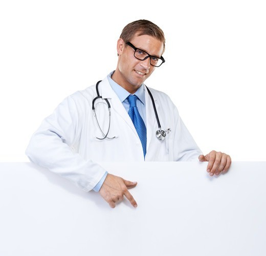 Stock Photo: 4197R-60279 Studio portrait of a handsome and confident young doctor pointing towards a blank placard isolated on white