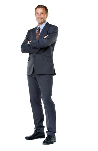 Full length of a successful businessman crossing his arms confidently : Stock Photo