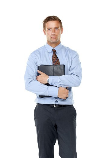 Stock Photo: 4197R-60344 A stoic executive keeping his business ideas close to his chest