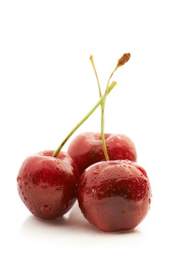 Stock Photo: 4197R-60650 Studio shot of a three fresh cherries isolated on white