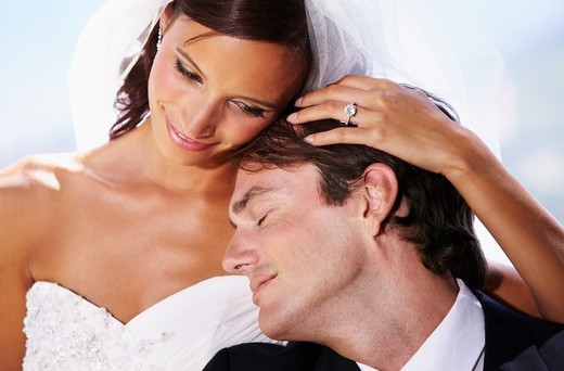 Stock Photo: 4197R-62466 Affectionate husband and wife on their wedding day