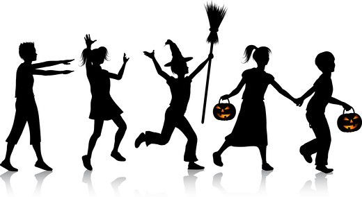 Stock Photo: 4198R-2087 Silhouettes of children playing on Halloween night