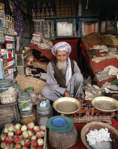 Portrait of a senior man sitting in his shop, Kabul, Afghanistan : Stock Photo