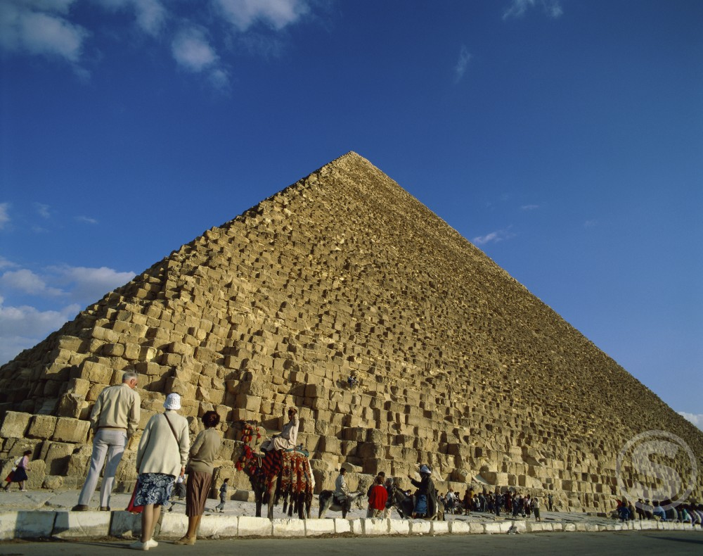Stock Photo: 42-4386 Tourists looking at a pyramid, Giza Pyramids, Giza, Egypt