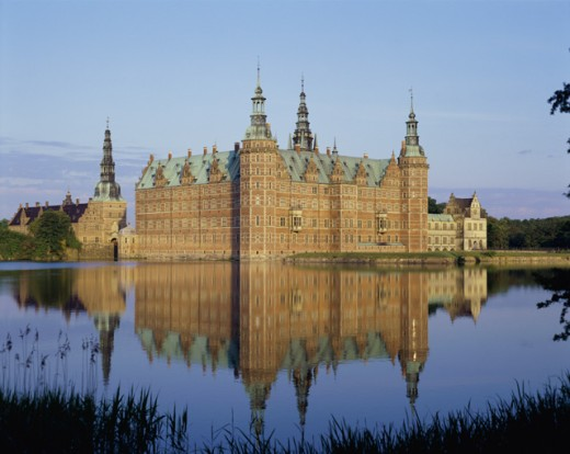 Stock Photo: 42-5801A Reflection of a castle in water, Frederiksborg Castle, Hillerod, Denmark