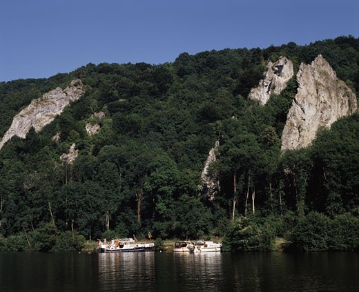 Boats in a river, Meuse River, Dinant, Belgium : Stock Photo