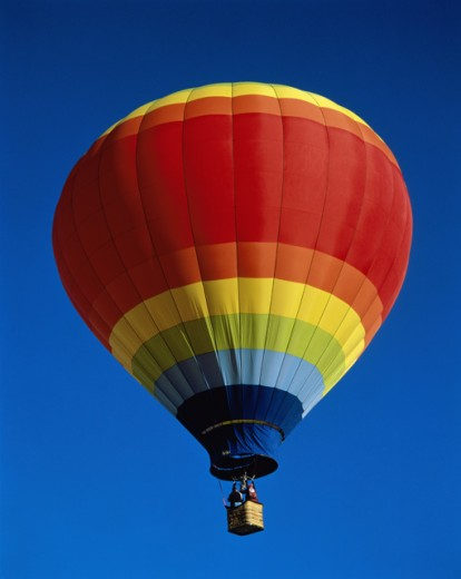 Low angle view of a hot air balloon rising, Albuquerque International Balloon Fiesta, Albuquerque, New Mexico, USA : Stock Photo