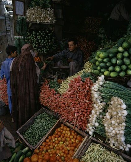 High angle view of a young man selling vegetables at a vegetable market, Kabul, Afghanistan : Stock Photo