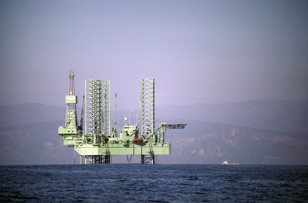 Drilling platform and supply boat, Santa Barbara Channel, California : Stock Photo
