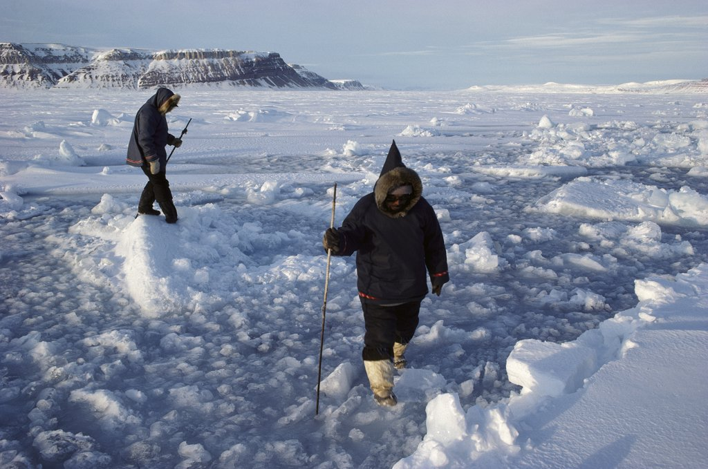 Stock Photo: 4201-13070 Inuits testing ice strength, Arctic Bay, Baffin Island, Canada