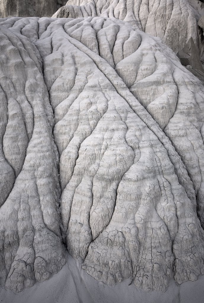 Stock Photo: 4201-41440 Close-up of intricate patterns of eroded sandstone cliffs in a small canyon near Churchwells, noon, Utah