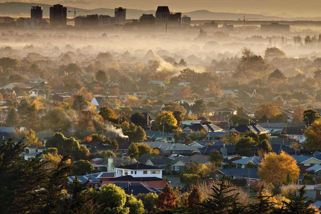 Smog from wood and coal fires blankets suburbs and city center on autumn dawn, Christchurch, Canterbury, New Zealand : Stock Photo