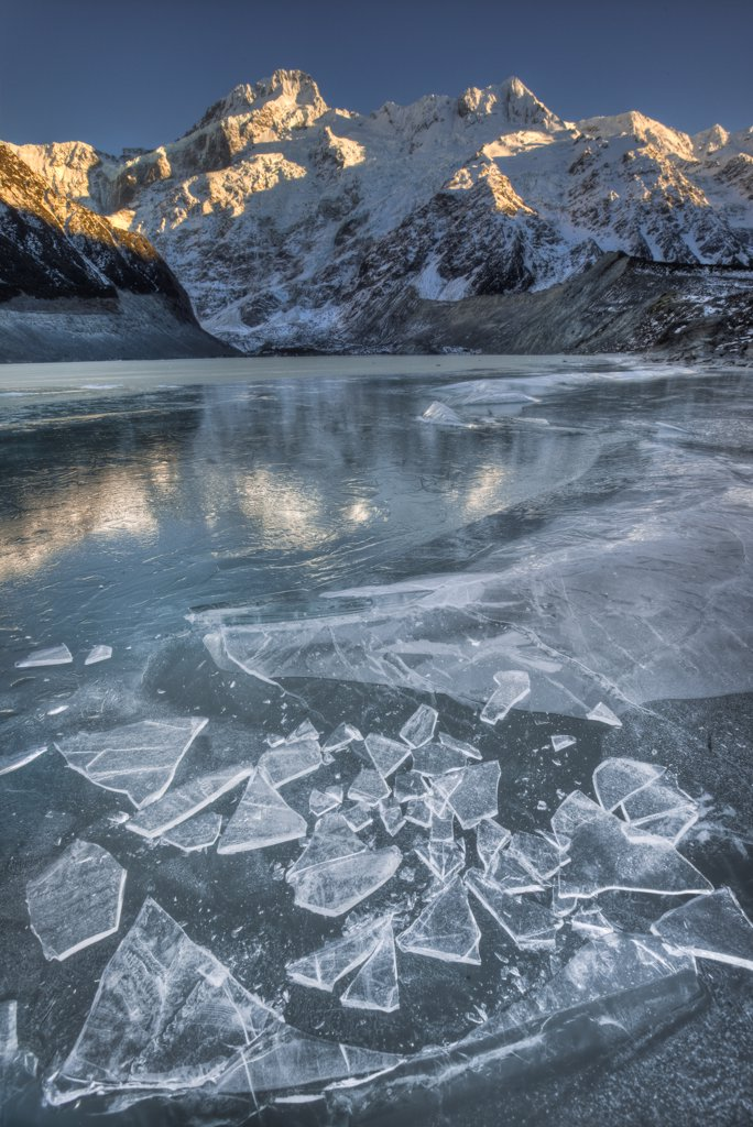 Stock Photo: 4201-52773 Mount Sefton reflected in frozen lake, Mueller Glacier, Mount Cook National Park, New Zealand
