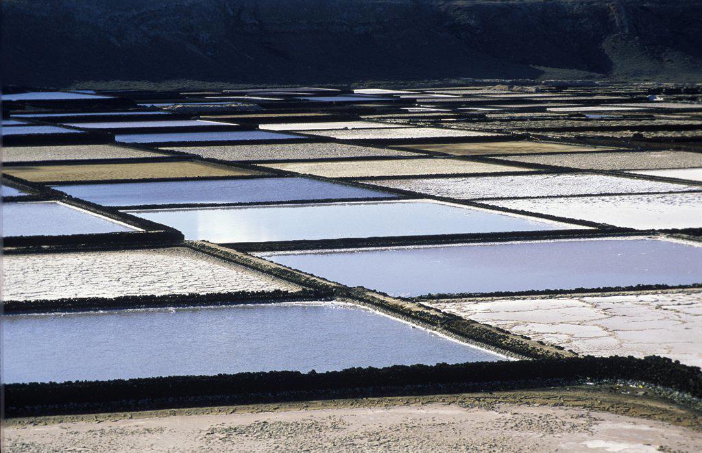 Old evaporative salt ponds of Janubio near Lanzarote, Canary Islands, Spain : Stock Photo