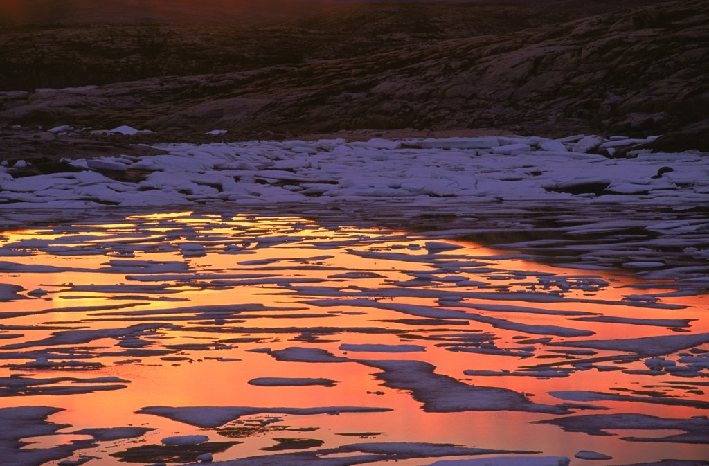 Stock Photo: 4201-8061 Melting ice reflecting midnight sunset, Wager Bay, Manitoba, Canada