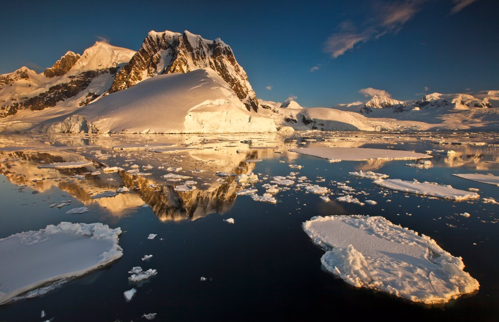 Lemaire Channel reflection at sunset, Antarctic Peninsula, Antarctica : Stock Photo