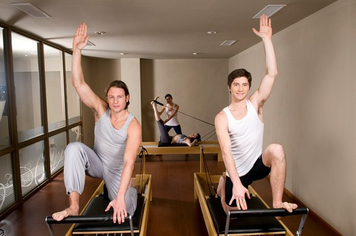Stock Photo: 4202R-196 Two young men exercising in a gym