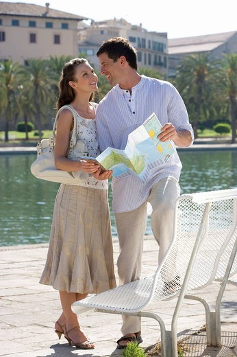 Stock Photo: 4208R-10230 Smiling couple holding map