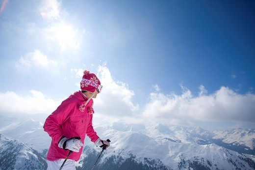 Stock Photo: 4208R-10839 Skier on mountain top looking at mountains