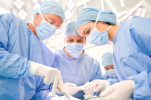 Stock Photo: 4208R-10969 Surgeons performing operation in hospital operating room