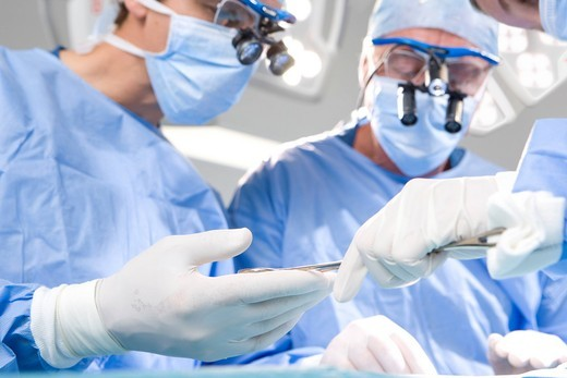 Stock Photo: 4208R-11187 Concentrating surgeons performing operation in operating room