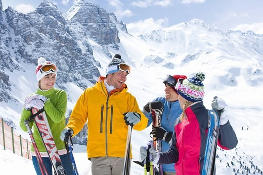 Stock Photo: 4208R-11222 Smiling skiers on mountain top