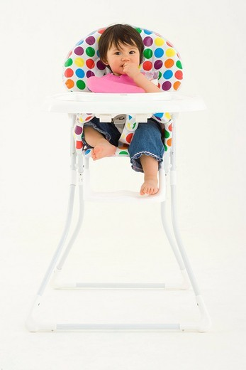 Baby girl 3-6 months in highchair, portrait : Stock Photo