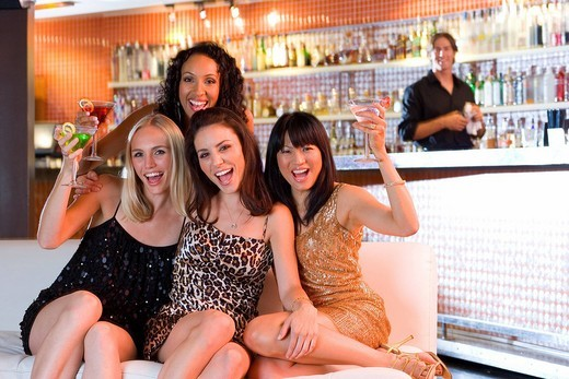 Stock Photo: 4208R-13491 Medium group of young women with drinks in bar, smiling, portrait