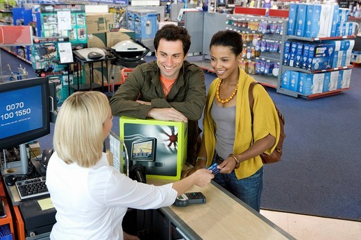 Stock Photo: 4208R-13653 Young couple buying computer, smiling, elevated view